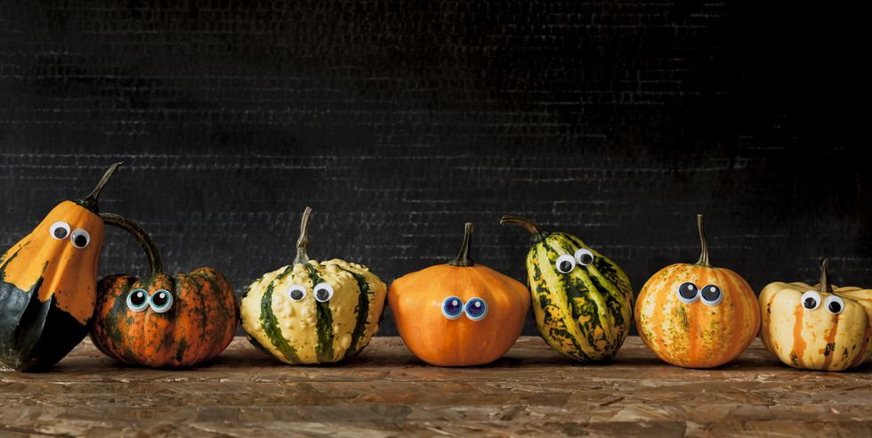 various different pumpkins with googly eyes
