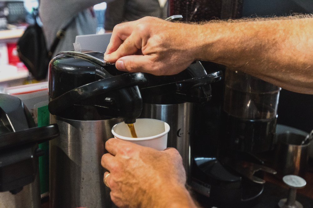 coffee being poured at Roebling Point Books and Coffee