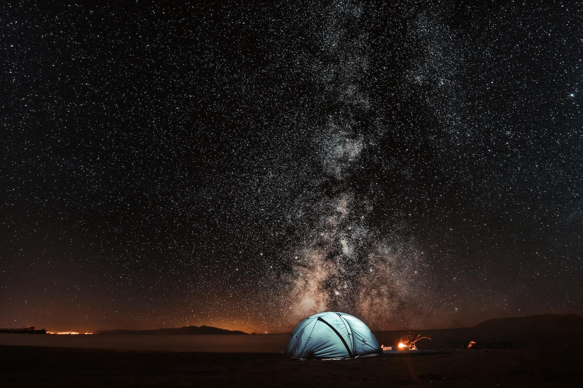 tent under star filled night sky