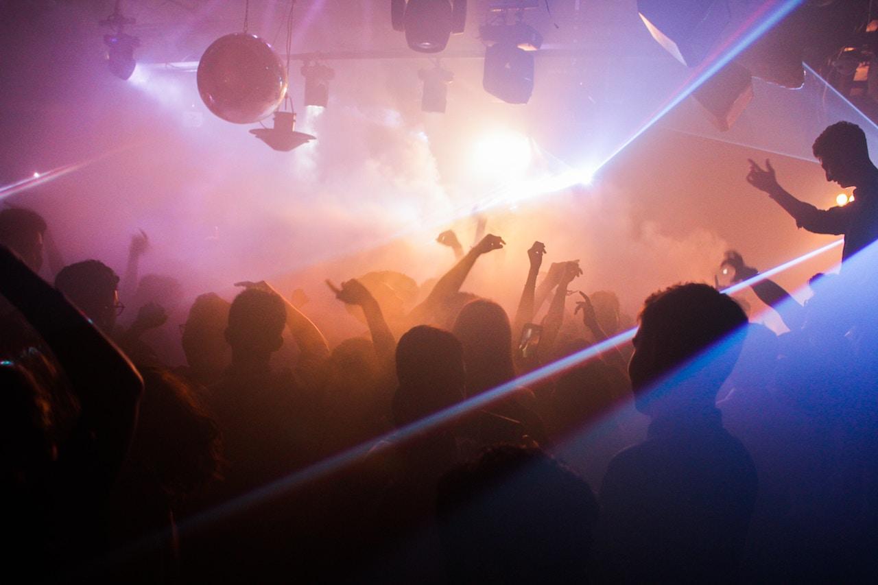 people dancing inside of club