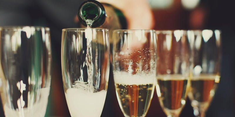 "champagne poured into glasses for ""No 'Pagne, No Gain"" New Year's Eve Wine Dinner"