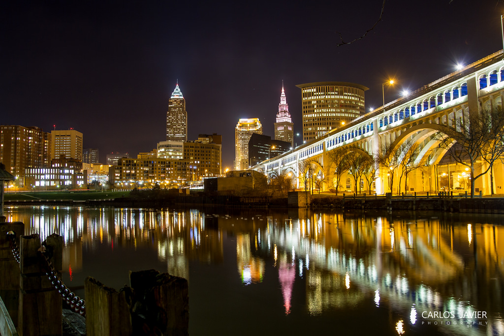 cleveland's holiday lights reflected in the water