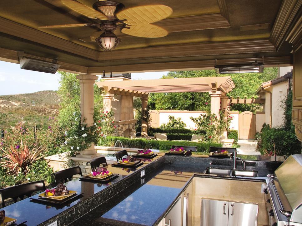amazing modern backyard with kitchen, hot tub, & more