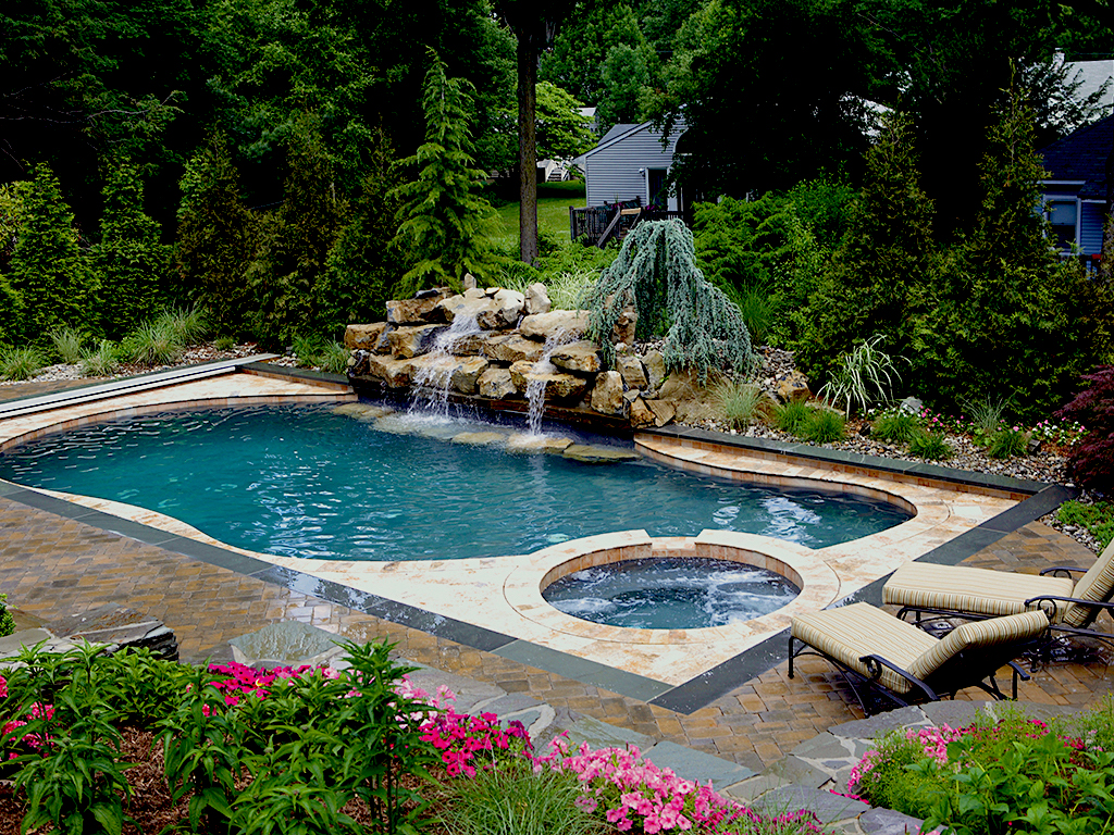 modern pool and hot tub sanctuary with fountain