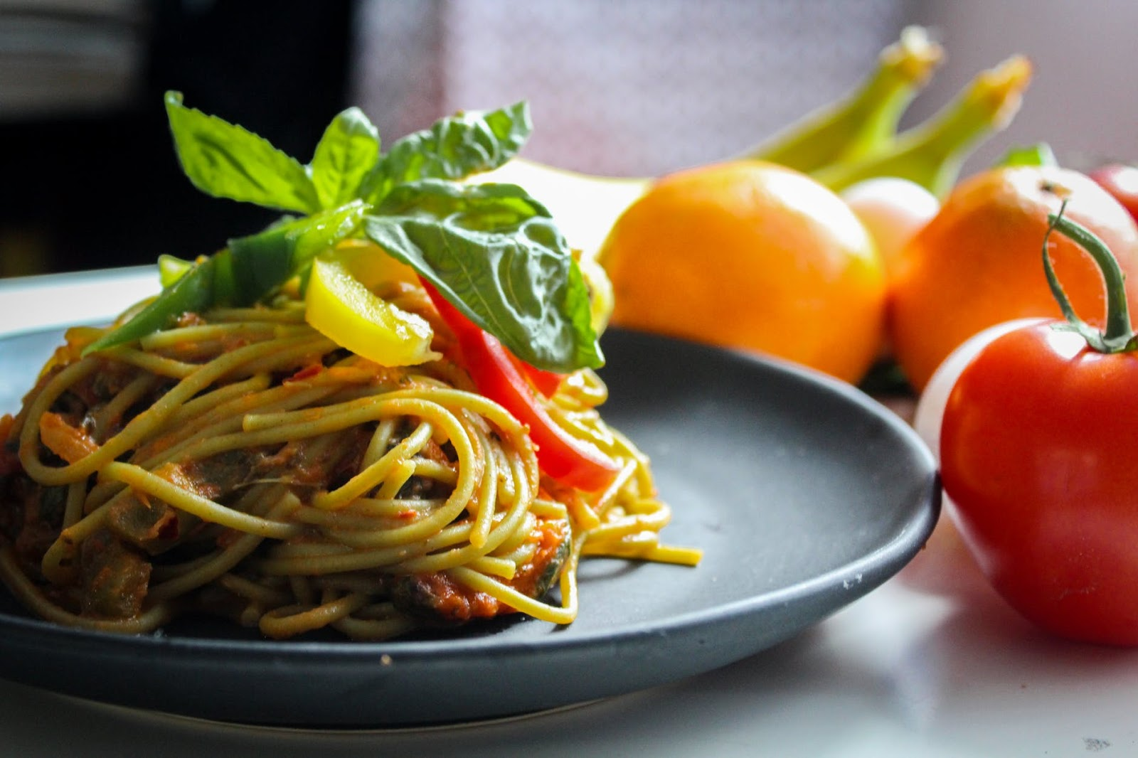 spaghetti dish next to fruit from Moretti's