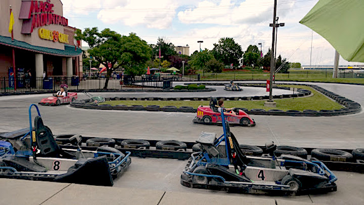 go-carts and track outside of Magic Mountain Building