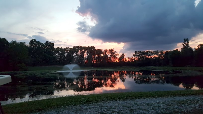 Sunset over Berkshire Lake with fountain