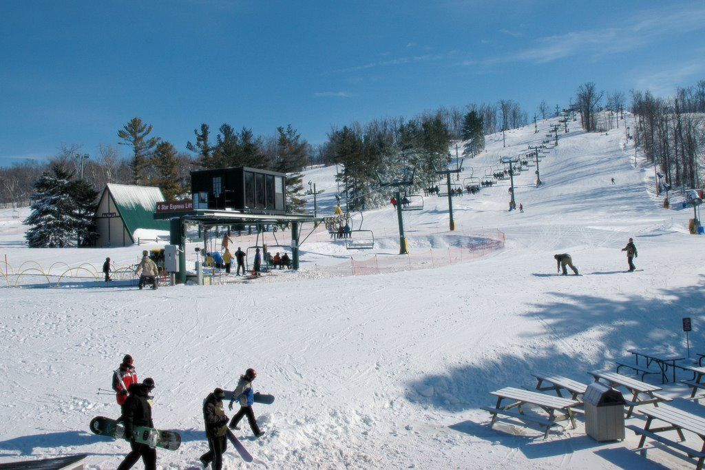 snow covered hill and snowboarders at Mad River Mountain OH