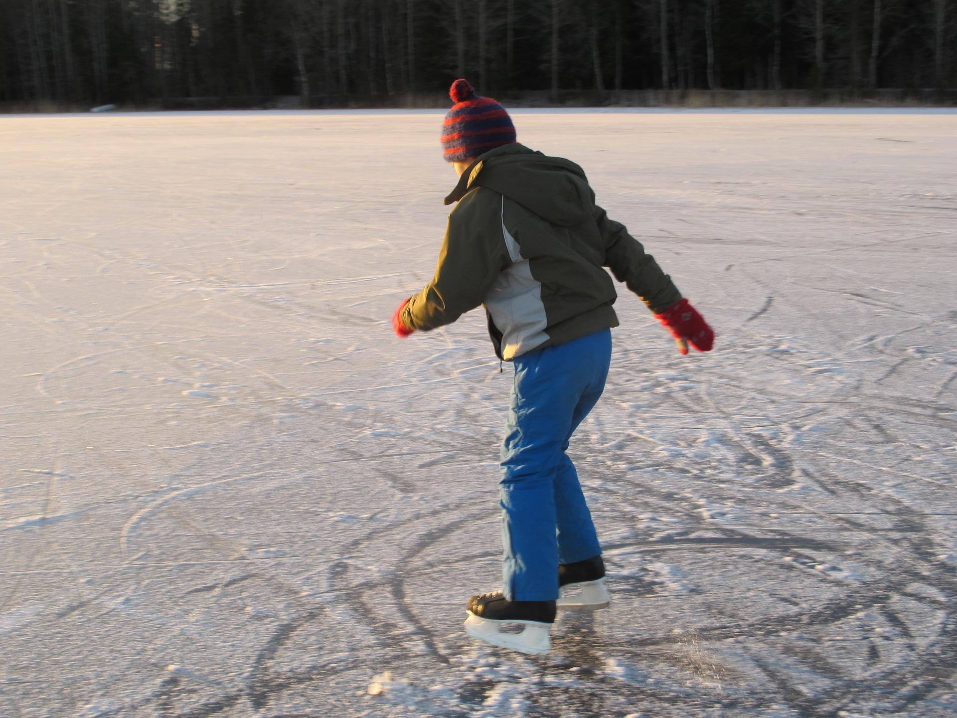 skater ice skating outside on frozen pond