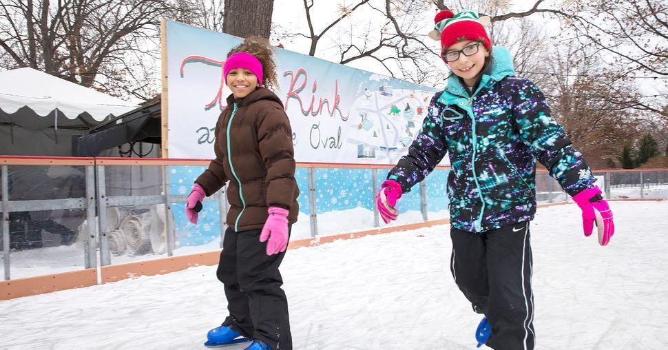 kids ice skating & smiling at The Rink at Wade Oval