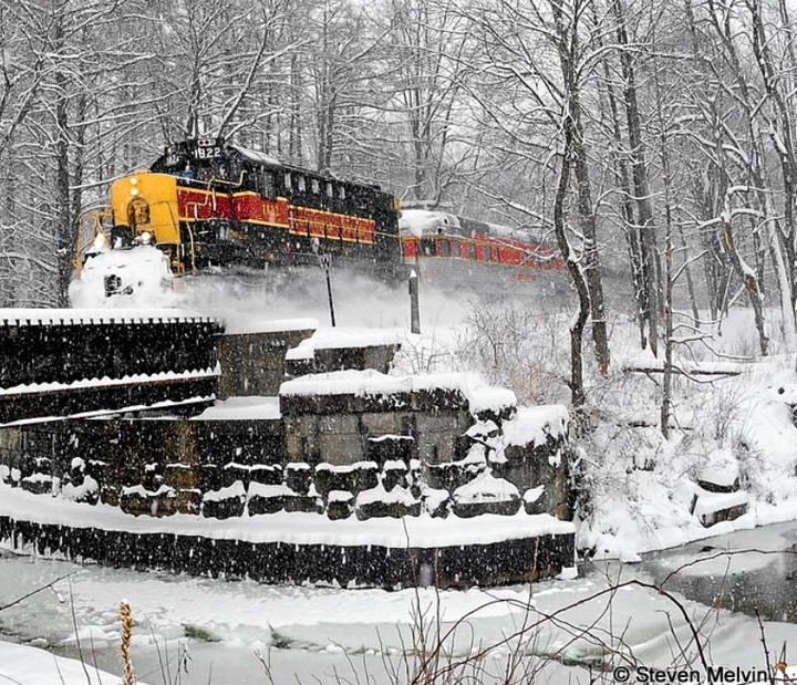 Cuyahoga Valley Train riding through snow at Railroad National Park
