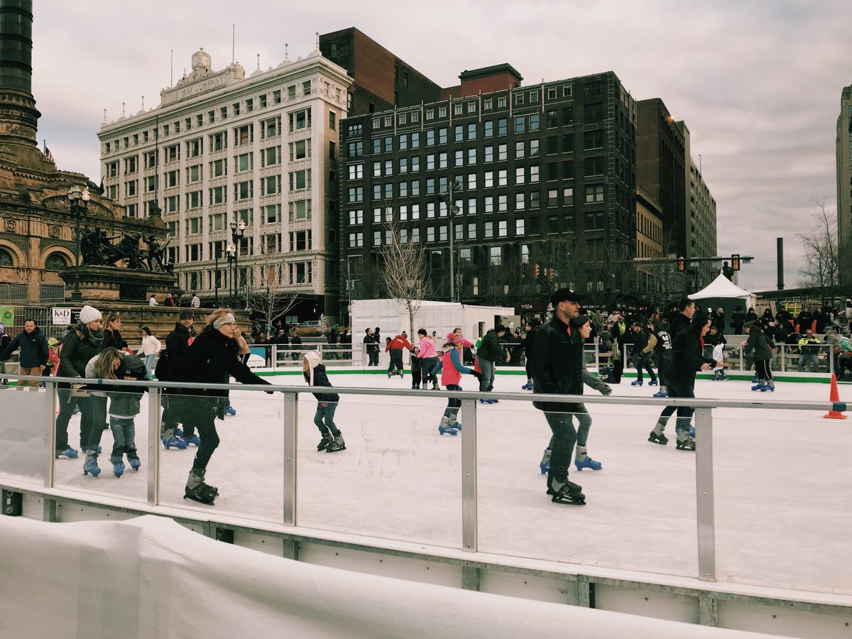 people ice skating on Cleveland Foundation Ice Rink in the public square