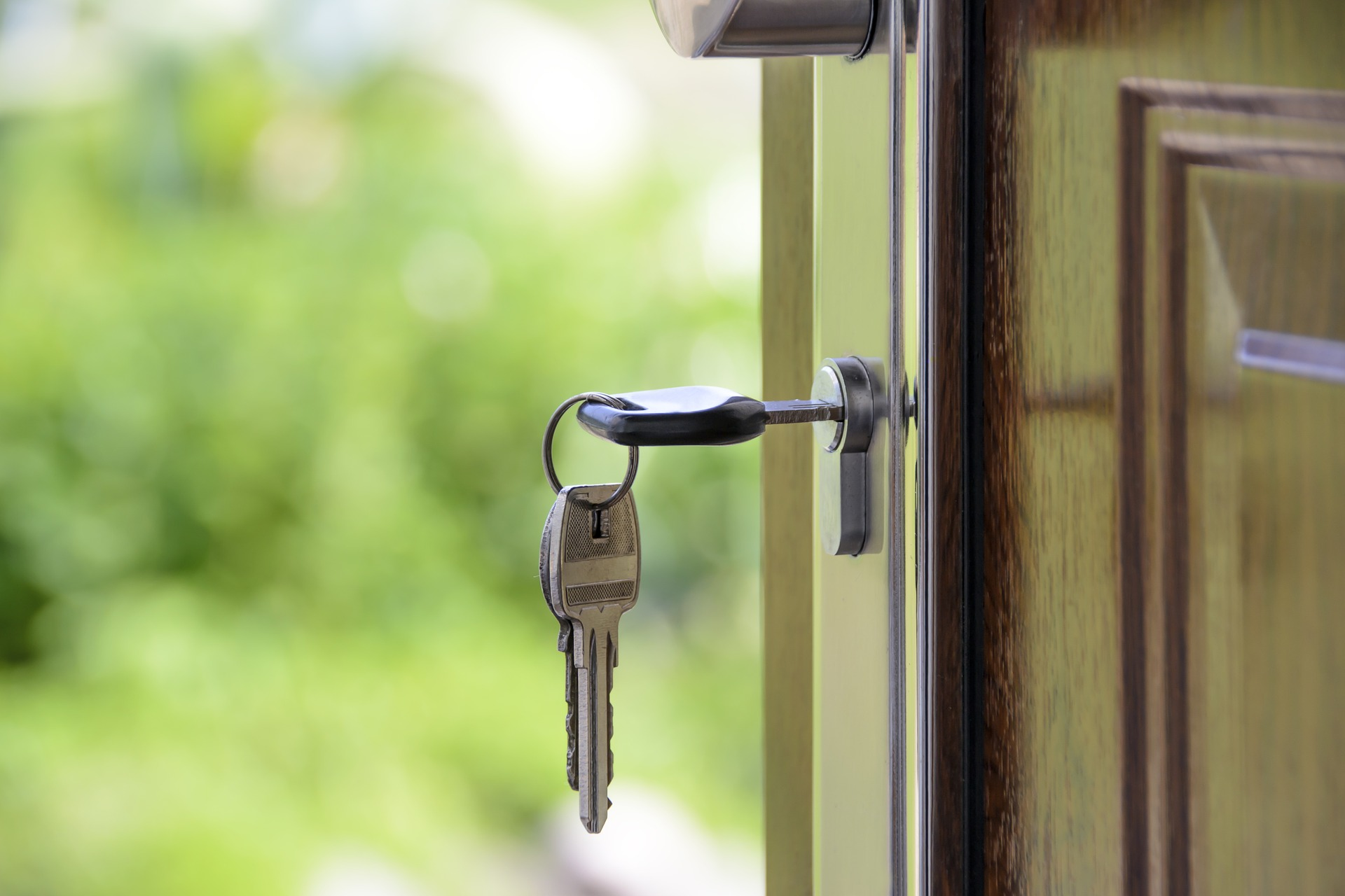 a key in the door of a home