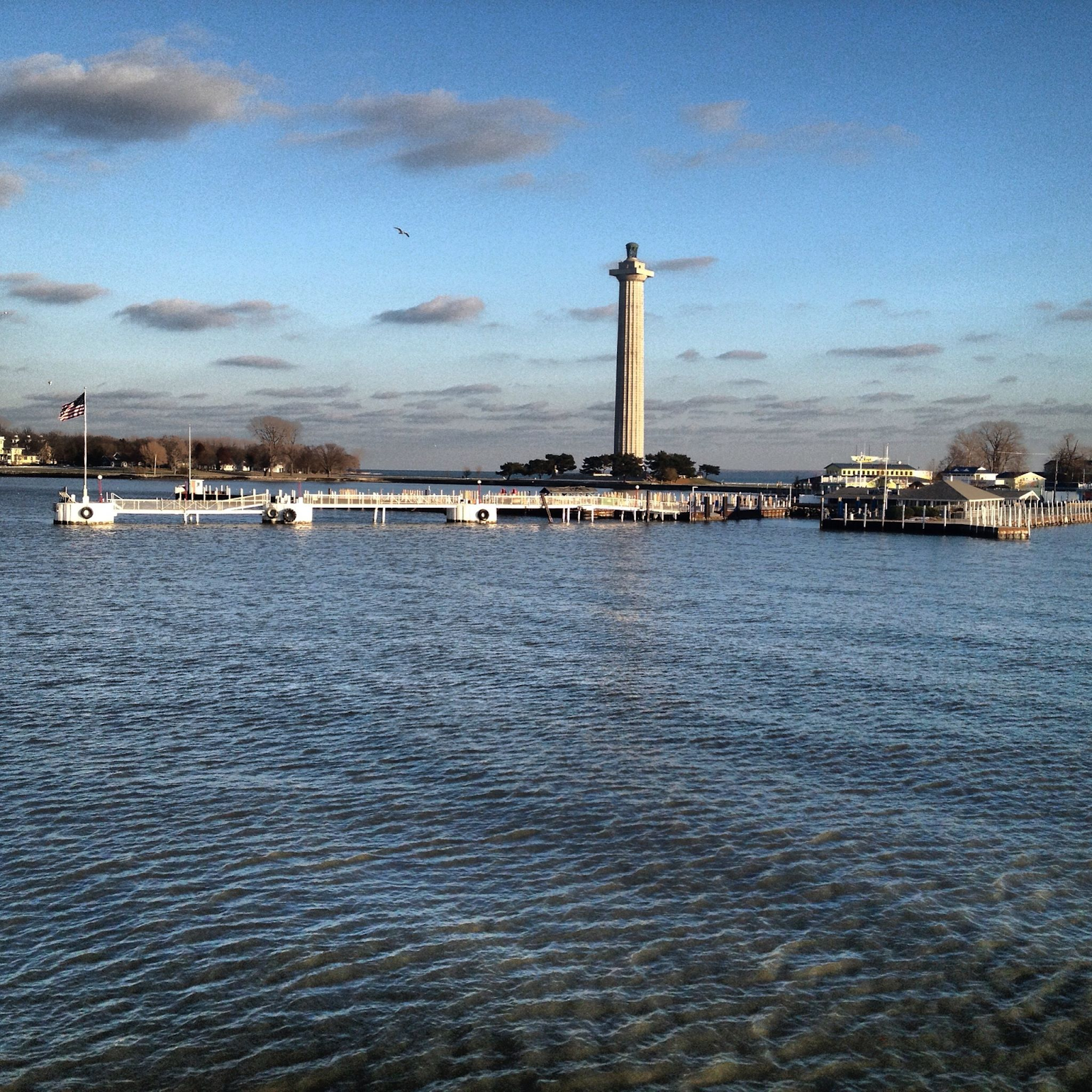 lighthouse, dock, and water of Put-in-Bay