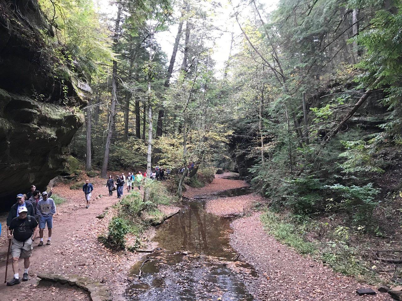 people hiking through Hocking Hills Ohio