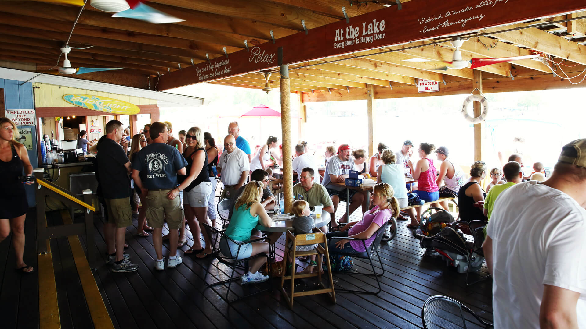 many people eating in Cranberry Resort Waterfront Bar & Restaurant at the lake