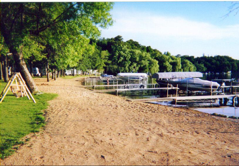 boat docks and sand trail in front of woods