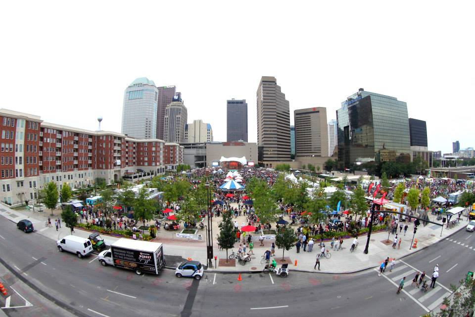 bird's eye view of Columbus food truck festival with buildings in the background