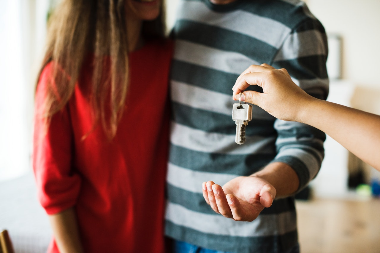 a couple receiving the keys to their new home
