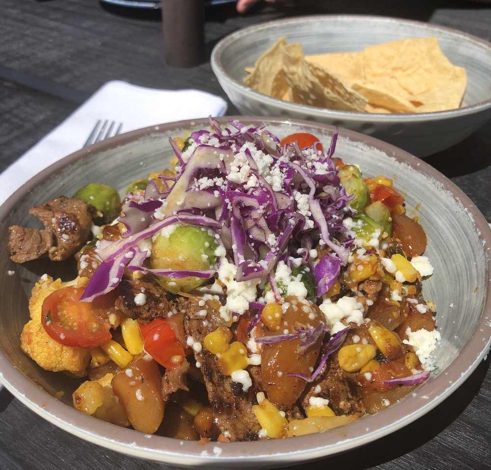A colorful plate of Mexican food from 12 West