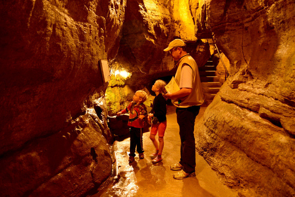 A dad and two kids touring the Olentangy Indian Caverns