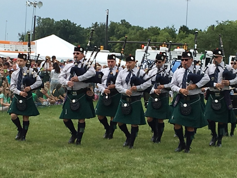a group of men in kilts play bagpipes at the dublin, ohio irish festival