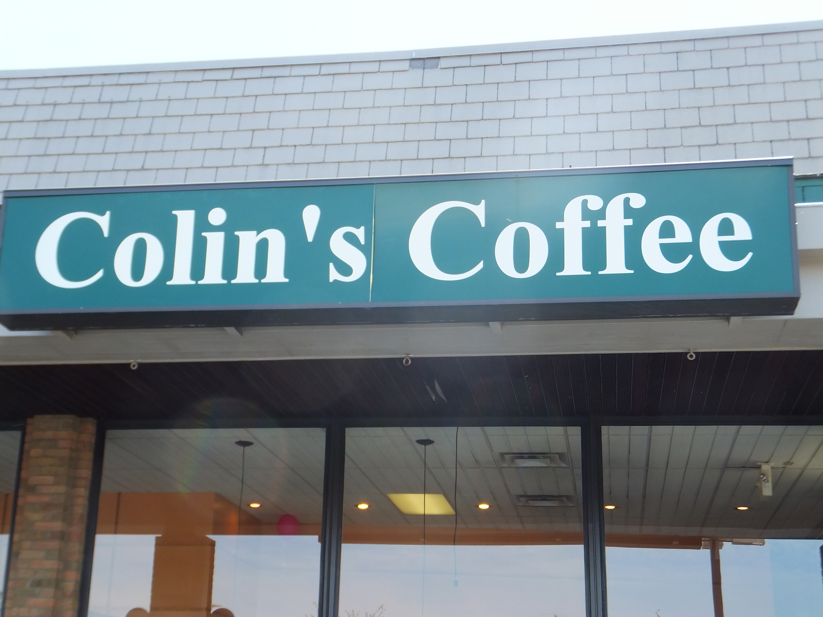 blue Colin's Coffee sign on building