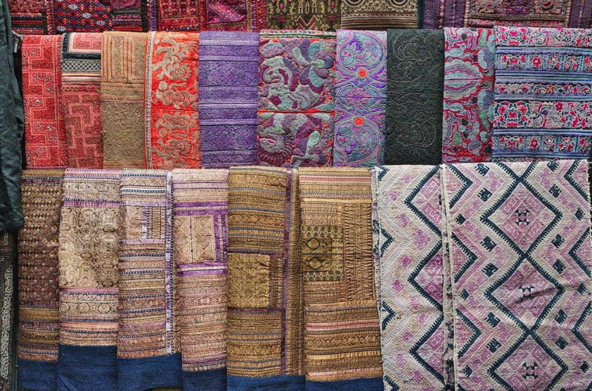 A display of rugs with a variety of colors and textures
