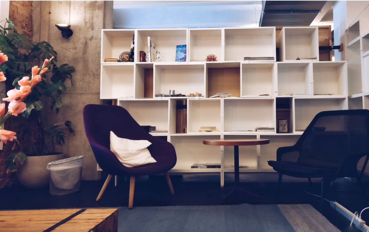 cubbies and chairs in a modernly furnished room