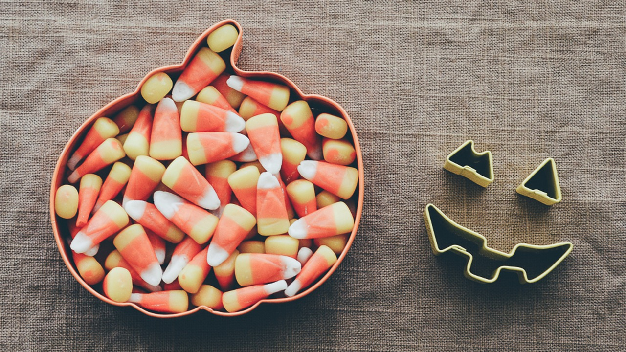 a pumpkin shaped bowl of candy corn