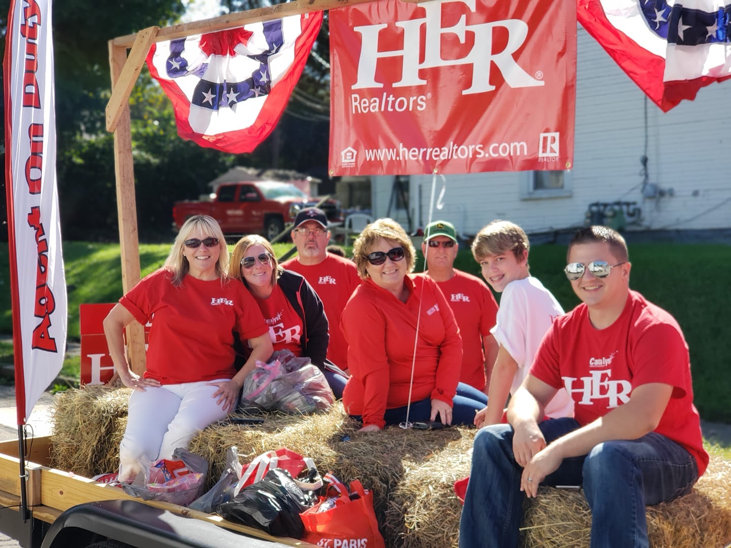 HER, REALTORS® agents clad in red at a brand picnic