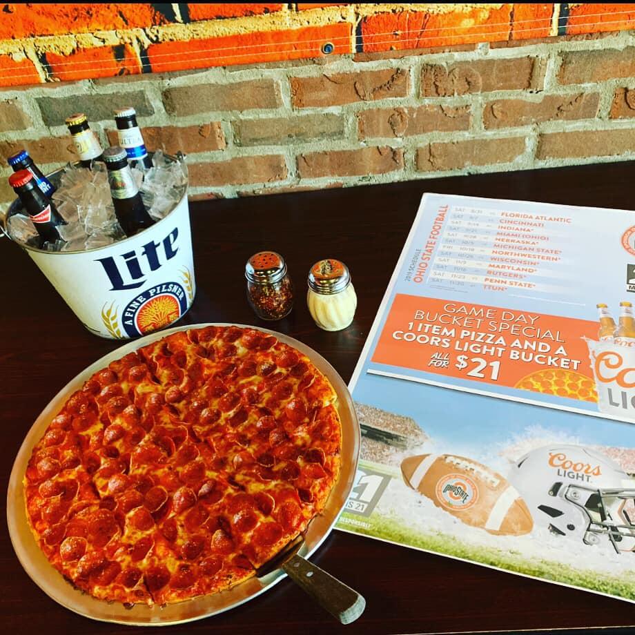 Beer, pizza, and menu at Granddad's pizza