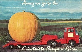 Truck lugging a large pumpkin