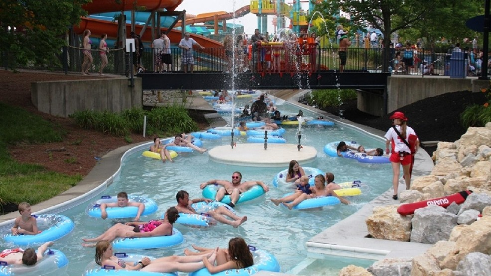 People relax on inner tubes as they float down a pool river at a waterpark