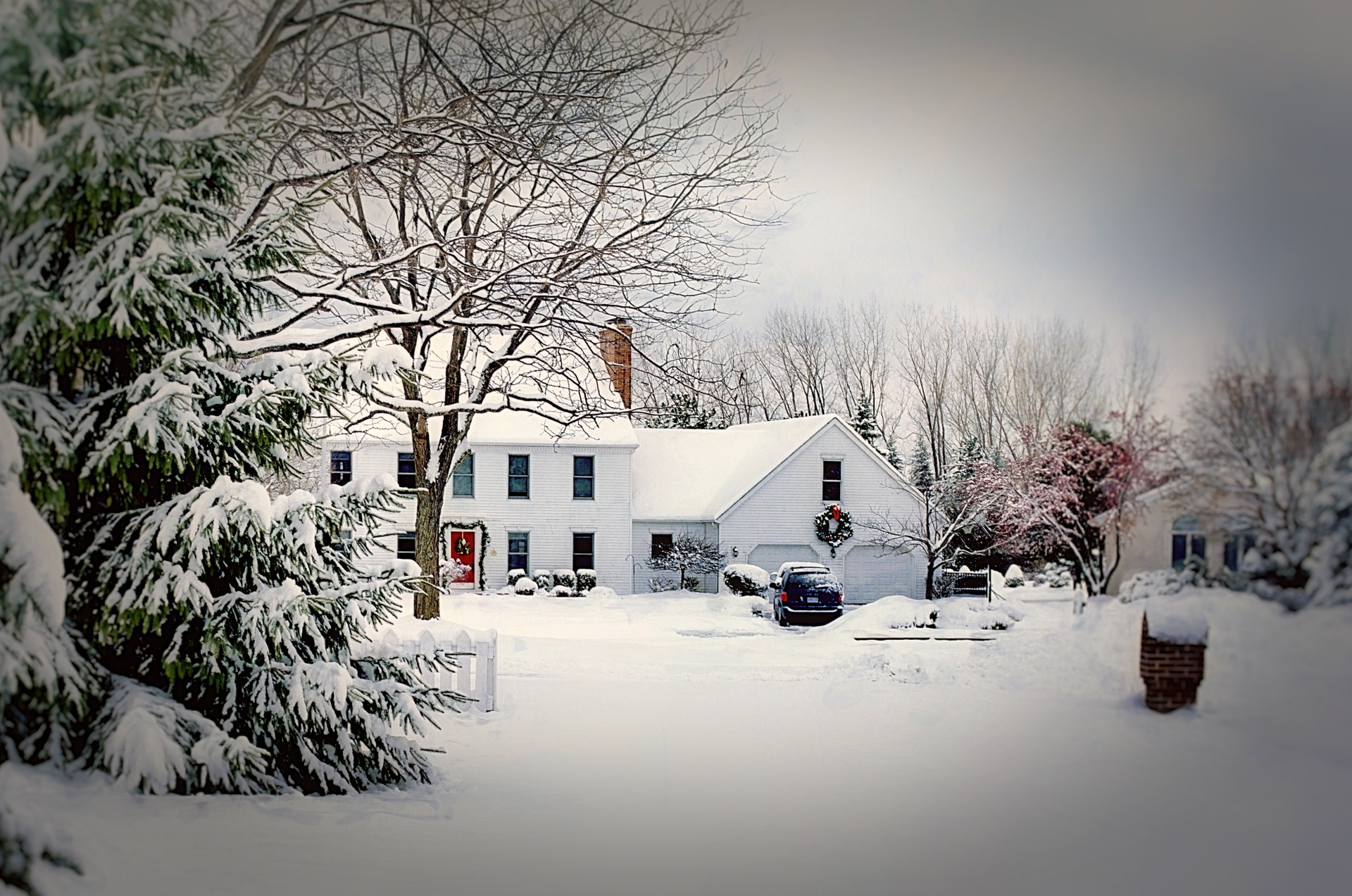 a home dusted in snow