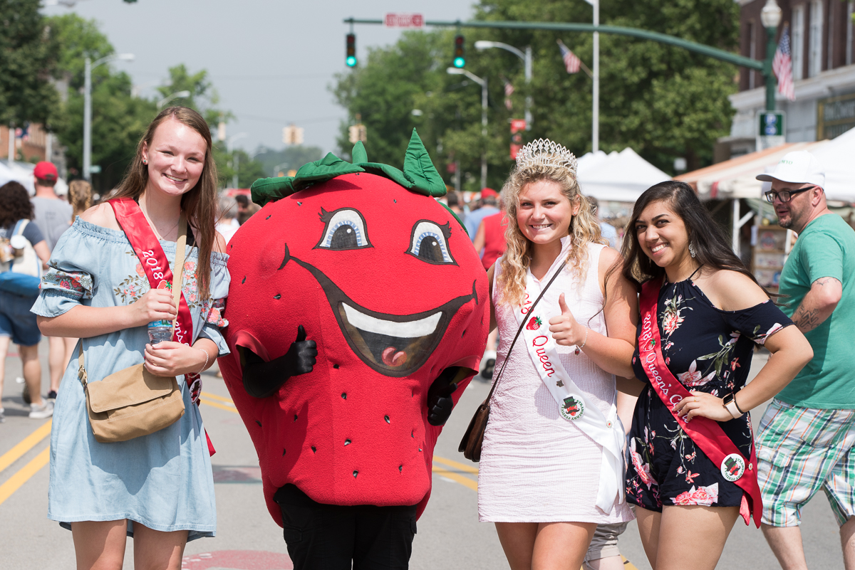 Strawberry Festival Queens post with the strawberry mascot