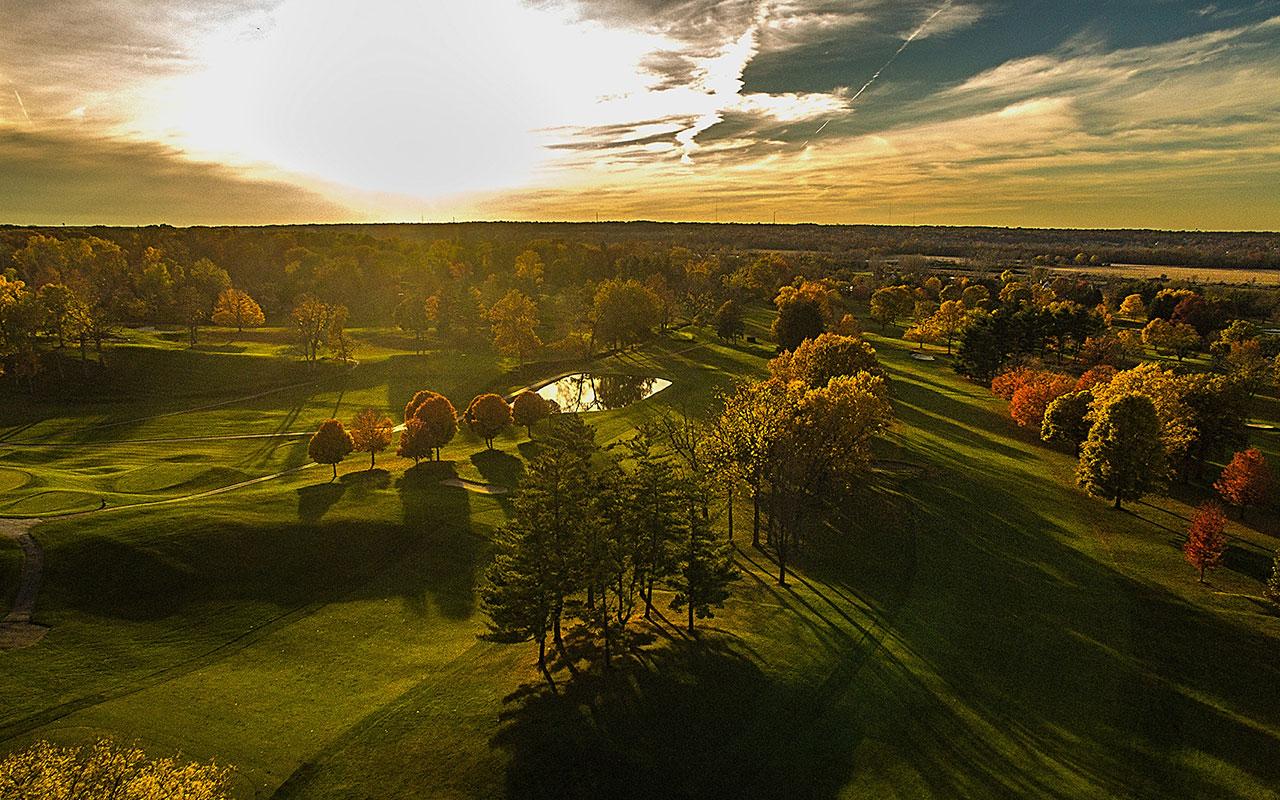 sunset over the grassy fields surrounding springfield, ohio