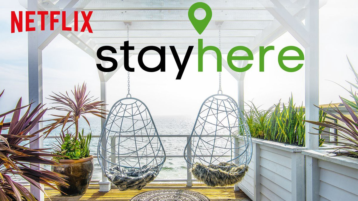 "Image of two hanging chairs overlooking an ocean from Netflix Show ""Stay Here"""