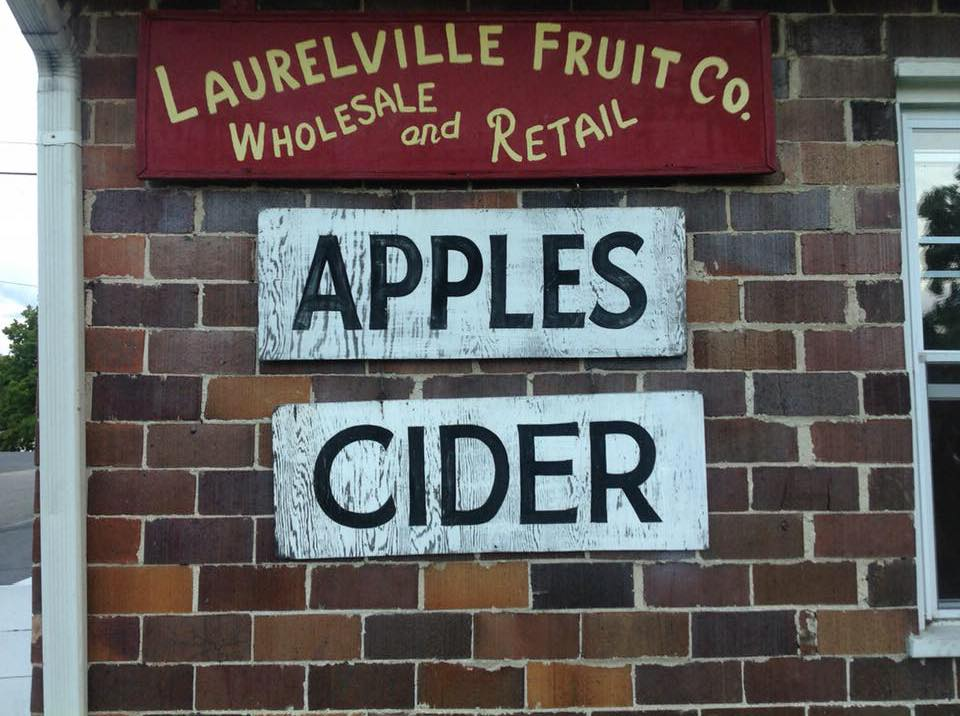 Exterior signs for Laurelville Fruit Co. say they have both apples and cider