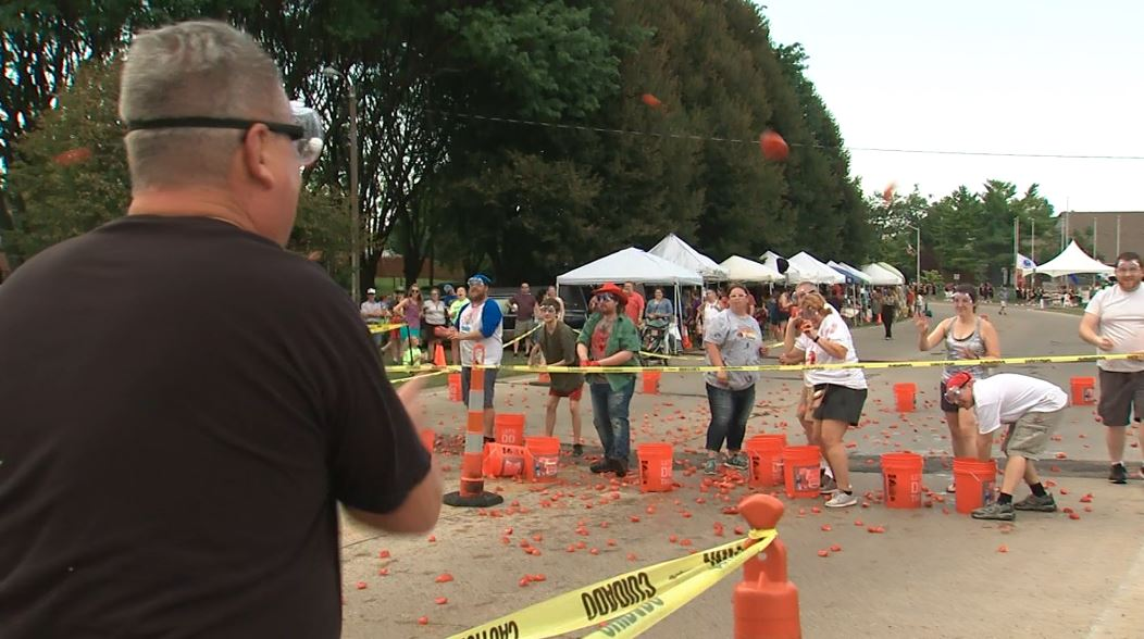 Residents at the Tomato Wars, throwing tomatoes