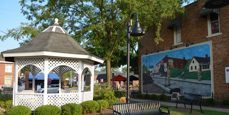 a gazebo and mural in a park in grove city ohio