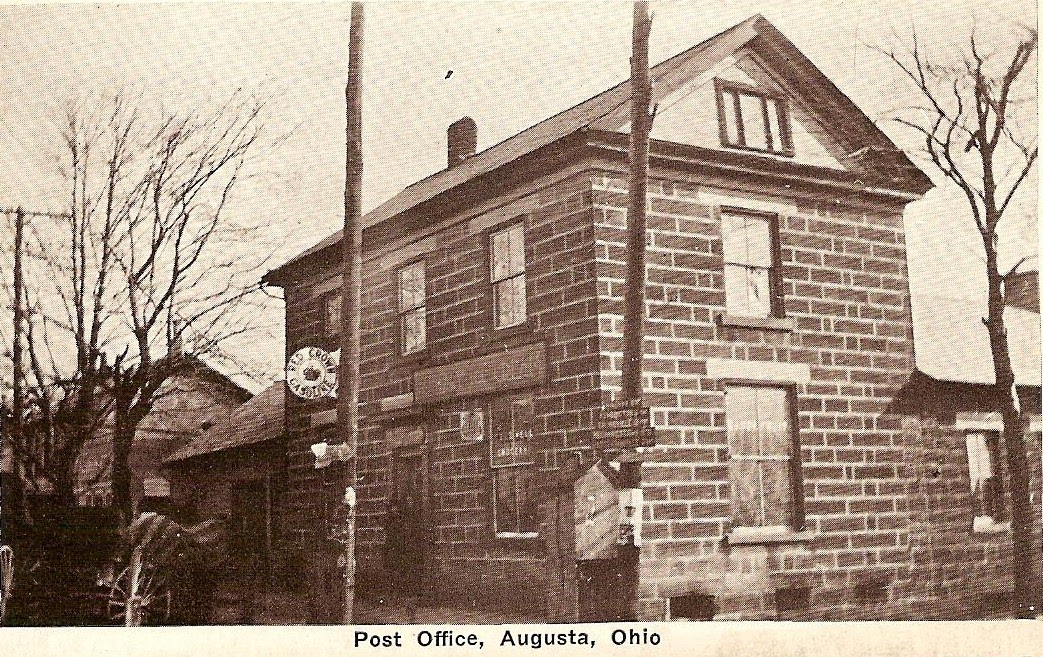 An old, black and white photograph of Augusta's first post office.