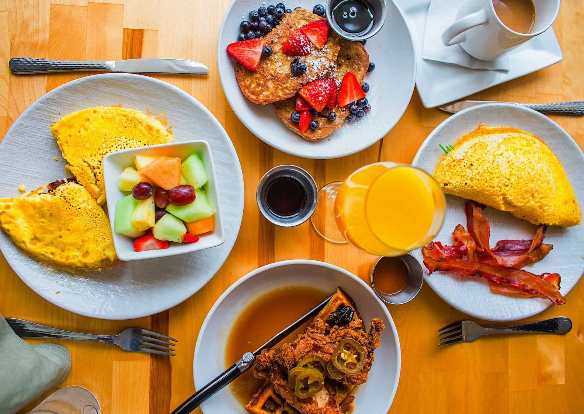 a colorful brunch spread with scrambles, mimosas, and fruit