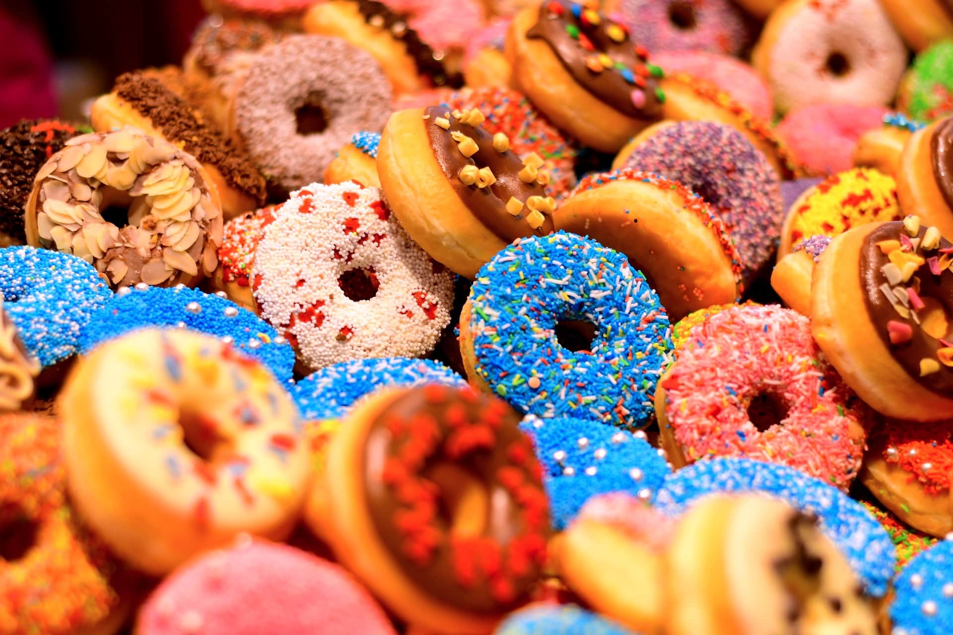 colorful selection of donuts with icing and sprinkles