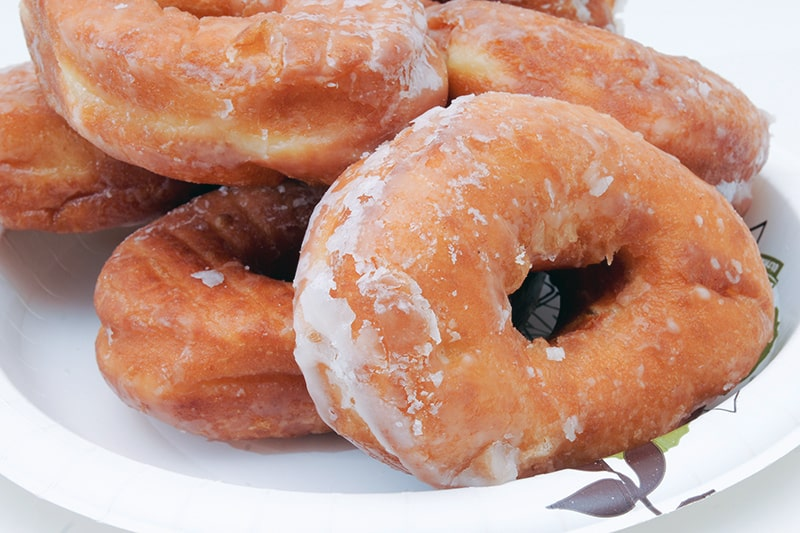 plate of glazed donuts