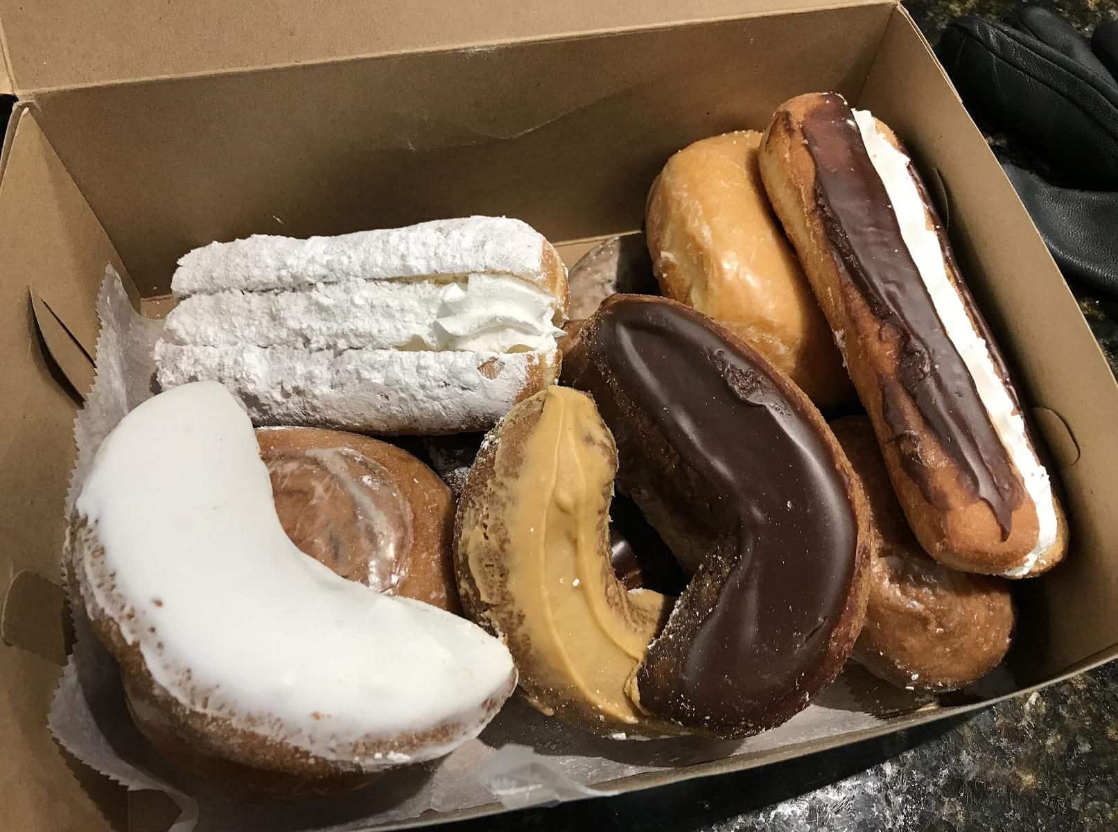 box of donuts and cream boats from Auddino's Italian Bakery