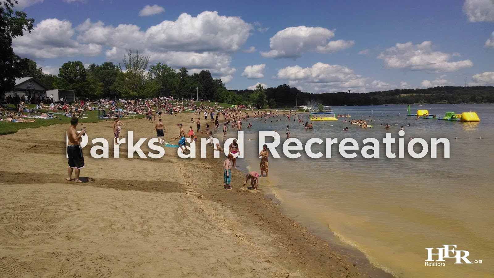 Kids and adults enjoying the sandy beach at Atwood Lake in Ohio.