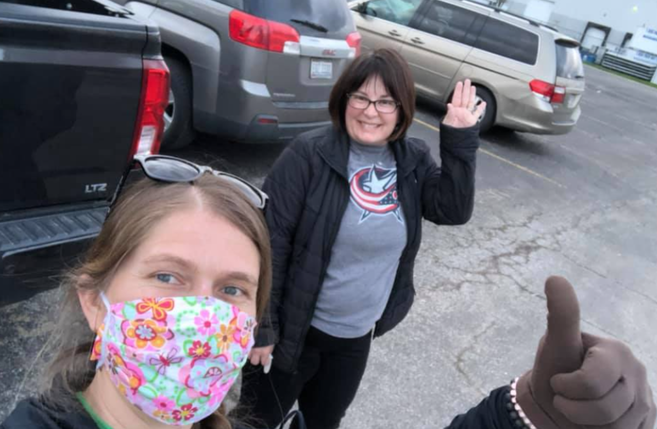volunteers in columbus wearing face masks pose for a picture