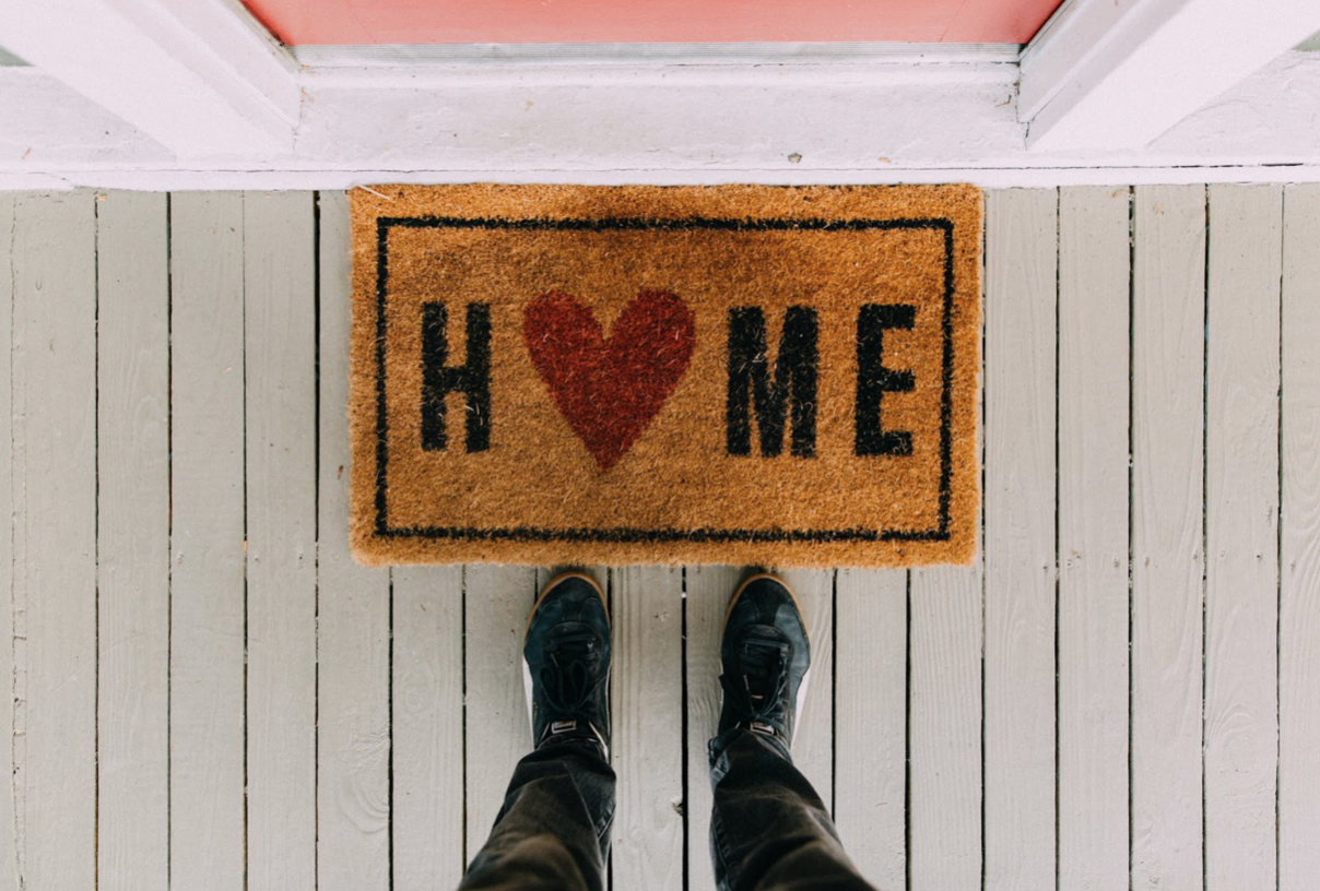 floor mat that says home with a heart