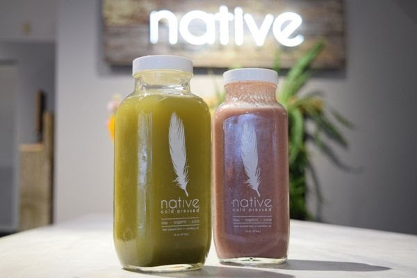 Two Native Cold Pressed organic juices with the logo in the background
